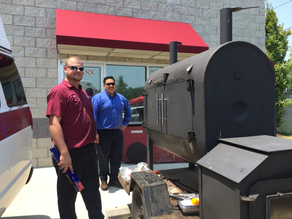 HomeTowne Auto Repair & Tire employees enjoy fun in the sun, and some BBQ